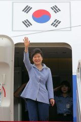 South Korean President Park Geun-hye waves before leaving for China from Seoul Military Airport in Seongnam, South Korea, on Wednesday.