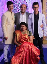 Mahesh Savani with his own family: wife Bhavna and their two sons.
