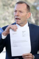 Tony Abbott with his 2015 letter confirming the earlier renunciation of his British citizenship.