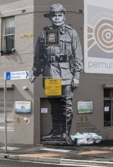 Black Anzac: A work by street artist Hego on the corner of Lawson Street in Redfern.