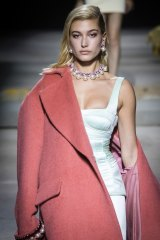 Model Hailey Baldwin wears a creation by Topshop at its London Fashion Week show.