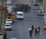 Police lead away a man whom they arrested in Lockwood Street, Merrylands.