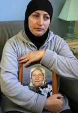 Killed: Salwa Haydar holding a picture of her mother in 2007.