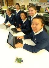 Students(L-R) Sarah Vandebberg, Georgia Grasso, Angie Liu, Erika Dudkin and Alice Shang, at Tara Anglican School in North Parramatta learn to code.