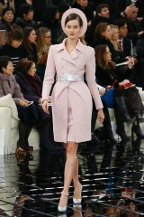 A pink tweed skirt suit that seemed to be inspired by Jackie Kennedy.