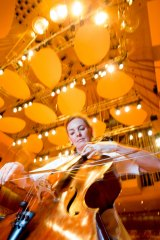 Catherine Hewgill, principal cellist in the Sydney Symphony Orchestra, plays under the new acoustic reflectors being tested in the Concert Hall of the Sydney Opera House.