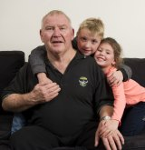 John Nicholson who has early onset dementia with his grandchildren Lincoln, 8, and Zara Nicholson.