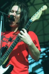 """Kim Deal on stage with the Breeders and """"pushing things forward""""."""