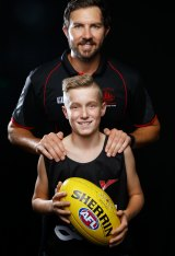 Harrison Parker with his AFL coach, Tyler Smith.