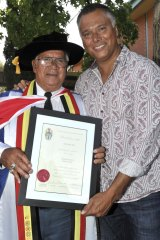 With his father, receiving his honorary doctorate from Charles Sturt University in 2013.