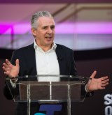 Telstra chief executive Andy Penn has been hit with a $1.6m pay cut