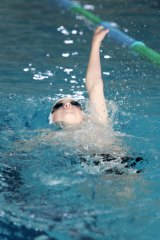 A young swimmer perfects his backstroke at Paul Sadler Swimland.