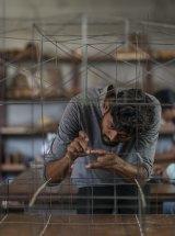 A worker in Bijoy Jain's Mumbai studio with a  prototype of the MPavilion design. Photo: Nicholas Watt