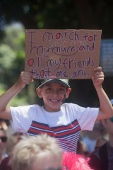 A young boy holds a sign at the Sydney march.