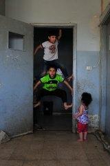 Syrian children play in the school in Baalbek, Lebanon.