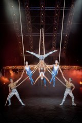 Performers in Quidam's Spanish web act hang from the telepherique.