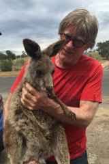 Marcus Ward with one of the kangaroos injured in the Lancefield fire.