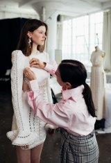 Nicky Zimmermann adjusts a model's look in the Zimmermann design studio in New York.
