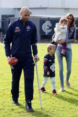 Chris and Rebecca Judd with their children Oscar and Billie at Ikon Park on Tuesday.