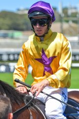 Jockey Tim Clark returns to scale after winning the Pierro Plate.