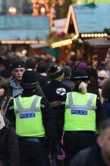 British police patrol Birmingham Christmas market.