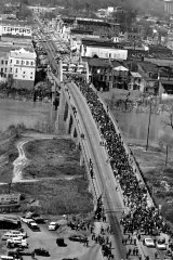 Civil rights marchers cross the Alabama river on the Edmund Pettus Bridge at Selma March 21, 1965, with Dr. Martin Luther King Jr. at the lead at the start of a five day, 50-mile march to the State Capitol of Montgomery for voter registration rights for blacks.