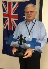 Space Systems Loral president John Celli, without a tie, holds a model of NBN's Sky Must II satellite.