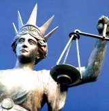 A 71-year-old woman has pleaded not guilty to charges of female genital mutilation.