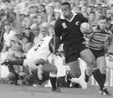 On the rampage: New Zealand winger Jonah Lomu moves past England's Will Carling on his way to score the opening try in Rugby World Cup semi-final clash at Newlands, Cape Town, on June 18, 1995.