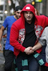 One of the 12 bouncers, Remzi Orcanoglu, who faces 10 charges following the stabbing outside CQ nightclub.