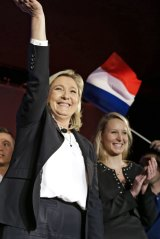 French far-right party leader Marine Le Pen, left, with the National Front regional leader for south-east France, Marion Marechal Le Pen, at a meeting in Nice.