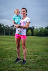 Lisa Weightman poses for a portrait with son Peter