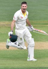 Victory jog: Marsh's century was a riposte to the doubters.