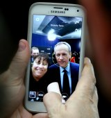 A woman takes a selfie with Opposition Leader Bill Shorten after the peoples' forum.
