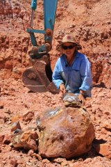 "Sue Cooper with a boulder that has been split to reveal ""colour"". There's no guarantee, even when boulders are next to each other."