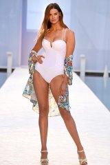 Robyn Lawley walks the runway at Miami Swim Fashion Week.