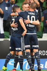 Berisha is congratulated after scoring from the spot, before he was shown the red card.
