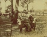Edith Coleman with her family in their Blackburn backyard, ca 1910.