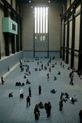 Visitors explore Ai Weiwei's installation Sunflower Seeds in the Tate Modern.
