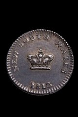 "The dump, cut from the centre of the ""holey dollar"", was worth 15 pence when it was in circulation."
