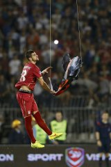 Serbia's Stefan Mitrovic grabs an Albanian flag that was flown over the pitch.