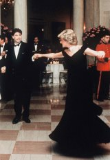 Princess Diana, wearing an evening dress designed by Victor Edelstein, dances with movie star John Travolta during her visit to America at the White House on November 9, 1985 in Washington, DC.