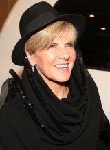 Foreign Affairs minister Julie Bishop wearing a black head scarf and hat arrives in Tehran, Iran, in the early hours of Saturday.