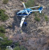Rescue workers being rappelled from an helicopter on the crash site near Seyne-les-Alpes, French Alps on Wednesday, March 25, 2015.