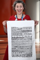 Lisa Carey with the tea towel at the ALP conference in Melbourne last month.