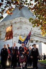 Descendants of the original Anzacs held an alternative service at the Shrine, after being banned from marching with their battalion banners.