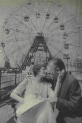 Wedding in front of the ferris wheel at at Coney Island..