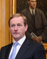 Taoiseach Enda Kenny says he doesn't agree with Tony Abbott's comments contained in his St Patrick's Day video message.