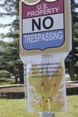 """A sign at the National Weather Service in Anchorage, Alaska, informs """"Pokemon Go"""" players that it's illegal to trespass on federal property."""