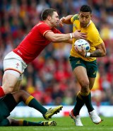 Australia's Israel Folau tries to make a break as he is tackled by George North.